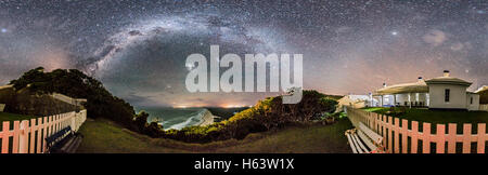 A 360° panorama and from horizon to zenith of the southern sky and Milky Way from Smoky Cape and the grounds of - Stock Photo