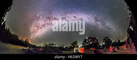 A 180° panorama of the southern sky Milky Way, from Sagittarius and Scorpius rising at left (east), across the south - Stock Photo