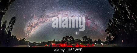 The spectacular southern Milky Way arching over the OzSky 2016 star party near Coonabarabran, NSW, Australia, in - Stock Photo