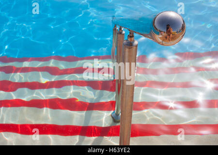 close up of metal handrail on steps into swimming pool - Stock Photo