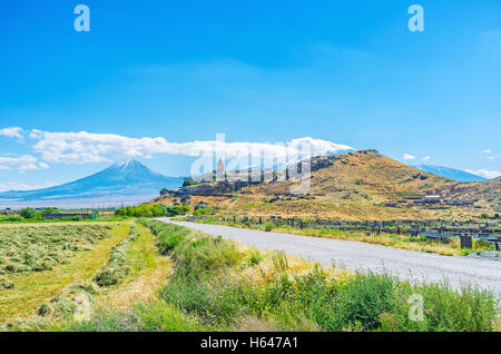 The way leads to the medieval Khor Virap Monastery, located on the hill with the Ararat Mount on background, Pokr - Stock Photo