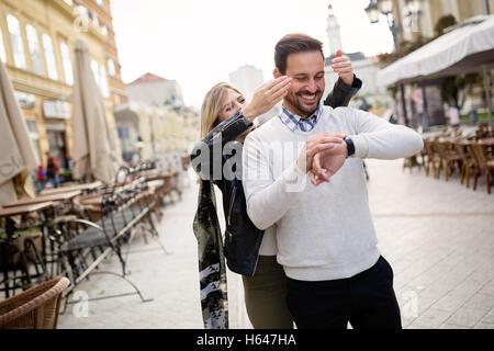 Beautiful girl surprises boyfriend waiting for her - Stock Photo