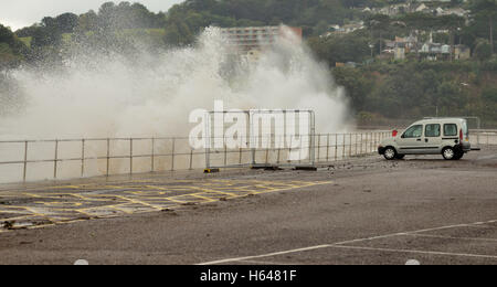 Rough weather at Teignmouth with waves crashing into the sea wall at high tide. - Stock Photo