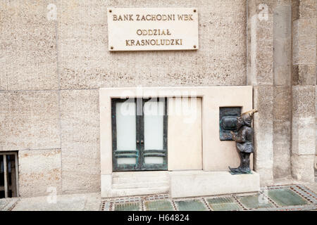 A dwarf using an ATM by the BZW bank in commemoration of the Orange Alternative movement in Wroclaw, Poland - Stock Photo