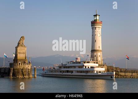 Ship Austria entering the harbor, harbor entrance, Bavarian lion, Neuer Lindauer Leuchtturm lighthouse, tour boat, - Stock Photo