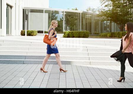Two women walking in high heels Stock Photo: 311025839 Alamy