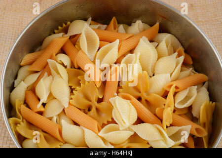 Variety of cooked pasta in stainless steel bowl - Stock Photo