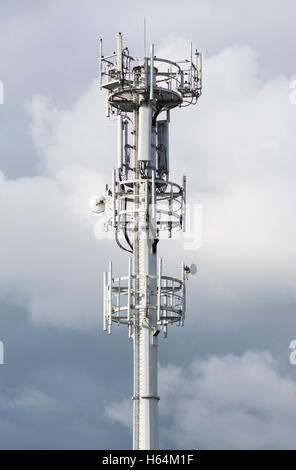 Communications and cell tower mast. - Stock Photo