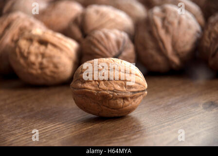 walnuts on the wooden-table. - Stock Photo