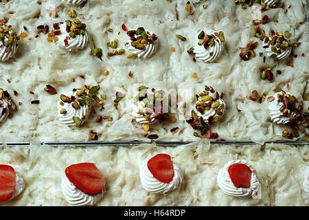 Güllaç / Turkish traditional milk dessert with pistachio and strawberry - Stock Photo
