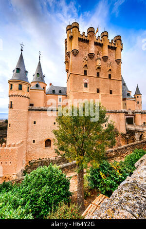 Segovia, Spain. The famous Alcazar of Segovia, rising out on a rocky crag, built in 1120.  Castilla y Leon. - Stock Photo