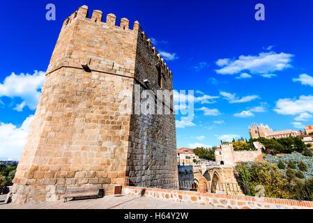 Toledo, Spain.  San Martin stone bridge across calm river. Popular tourist place in Europe. - Stock Photo