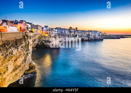 Puglia, Italy. Sunset scenery of Polignano a Mare, town in the province of Bari, Apulia, southern Italia on the - Stock Photo