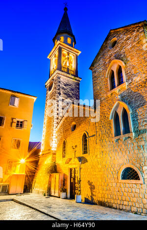Budva, Montenegro. Sveti Ivan (St. John) Catholic Church Cathedral rises over the old town and harbor. - Stock Photo