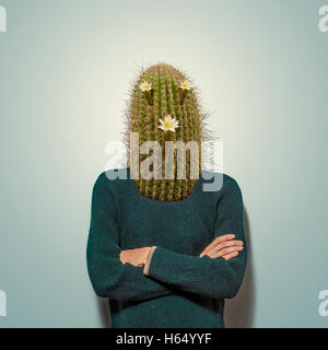 Young man with cactus head - Stock Photo