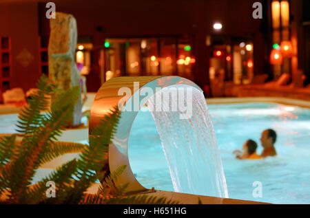 Relaxation pool in spa with waterfall - Stock Photo