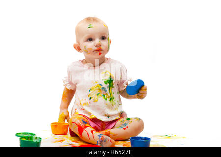 little girl soiled by multi-colored paints - Stock Photo