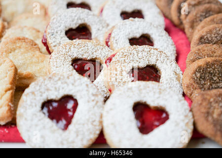 Round cookies with heart-shaped middles. Close up. - Stock Photo