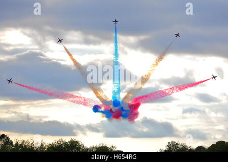 Red Arrows in their BAE Hawk T.1 performing a perfect maneuver at Biggin Hill Air Show 2014 - Stock Photo