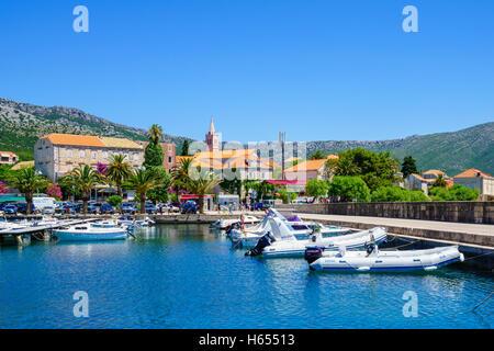 Orebic, CROATIA - JUNE 25, 2015: Scene of the port, and the town center, with locals and tourists, in Orebic, Croatia - Stock Photo