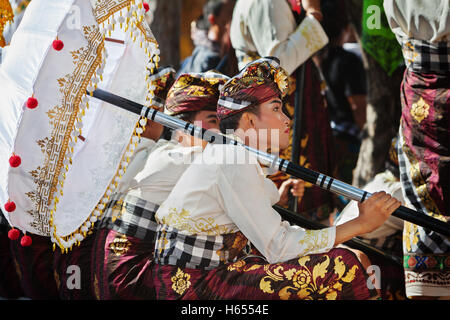 Denpasar, Bali island, Indonesia - June 11, 2016: Beautiful young man in traditional Balinese people costume sarong. - Stock Photo