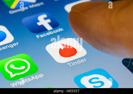 Tinder online dating app close up on iPhone smart phone screen - Stock Photo