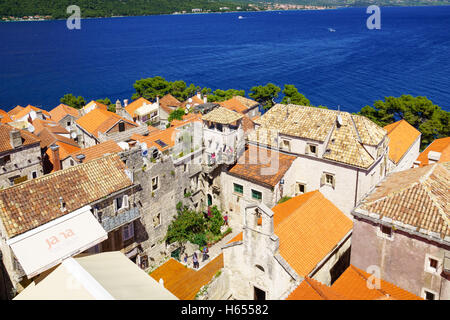 KORCULA, CROATIA - JUNE 25, 2015: Rooftop view of the old town, with the House of Maco Polo, locals and visitors, - Stock Photo