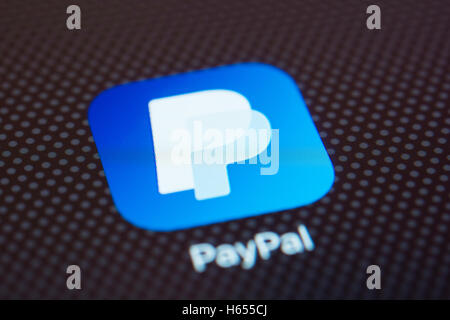 Paypal online banking app close up on iPhone smart phone screen - Stock Photo