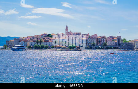 KORCULA, CROATIA - JUNE 26, 2015: Scene in the old town (west side), with the walls, houses, boats, locals and visitors, - Stock Photo