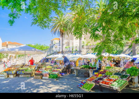 KORCULA, CROATIA - JUNE 26, 2015: Market scene in Kralja Tomislava square, with sellers and shoppers, in Korcula, - Stock Photo