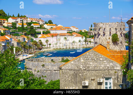 KORCULA, CROATIA - JUNE 26, 2015: Scene of the old town, with The Small Governor Tower, the bay, boats, locals and - Stock Photo