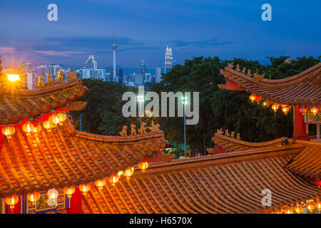 Dusk view of Kuala Lumpur skyline as seen from Thean Hou Temple illuminated for the Mid-Autumn festival, Malaysia. - Stock Photo