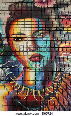 Colourful mural depicting a woman on the side of a building in downtown Toronto, Ontario, Canada. - Stock Photo