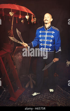 Circus performer holding a swords - Stock Photo