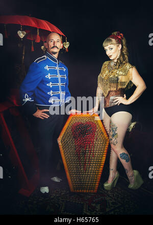 Circus performers with a bed of nails - Stock Photo
