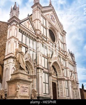 Statue of Dante Alighieri, in the Piazza Santa Croce, besides the Basilica of Santa Croce in Florence, Italy. - Stock Photo