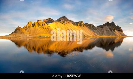 Panoramic view of the reflected Vestrahorn mountain, Hofn Stokksnes Peninsula Iceland. - Stock Photo