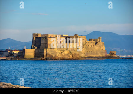 Naples, Italy. Dell'Ovo Castle view from seafront Francesco Caraccilolo. - Stock Photo