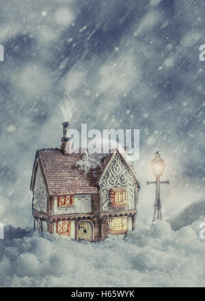 Winter cottage in snow - Stock Photo
