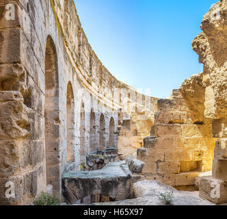 Some of constructions in the old Roman amphitheatre were ruined, but the main wall is in good condition, El Jem - Stock Photo