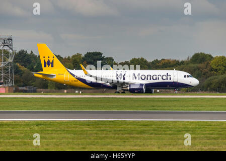 Airbus A320-214  G-ZBAS Monarch Airlines Manchester Airport England Uk. Arrivals, departures. landing, take off. - Stock Photo