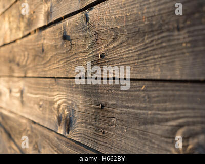 Old weathered wooden planks, shallow depth of field - Stock Photo
