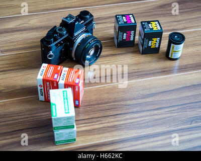 Moscow, Russia - June 17, 2016: Analogue Photography. Fujicolor, Agfacolor, ILFORD and Adox 35mm film rolls and - Stock Photo