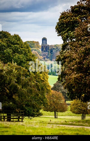 Beautiful autumn colours at Wentworth Woodhouse gardens with the mausoleum in the distance - Stock Photo
