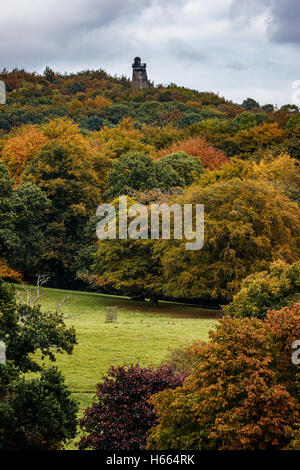 Beautiful autumn colours at Wentworth Woodhouse gardens with Hoober Stand on the horizon - Stock Photo