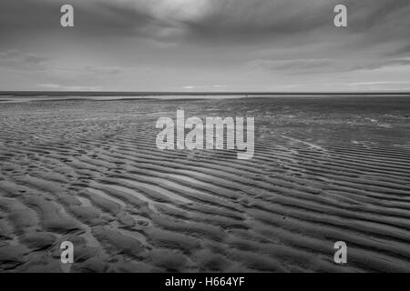Dark, moody sunset on the beach in Blackpool, England Stock Photo