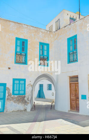 All the houses in old neighborhoods are white and the windows and doors offen painted in blue color, according to - Stock Photo