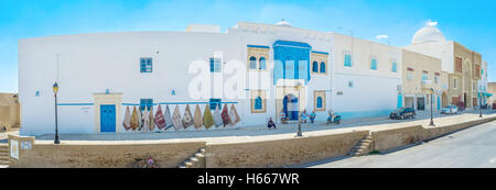 The historic neighborhood next to the Grand Mosque is occupied by numerous rug stores and workshops - Stock Photo