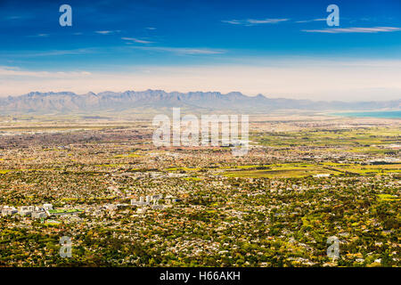 Panoramic view of Cape Town towards Stellenbosch mountains from Table Mountain in South Africa - Stock Photo