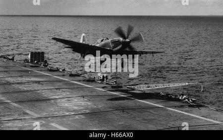 Fairey Firefly fighter lands on the flight deck of Royal Navy aircraft carrier HMS Unicorn 1950 - Stock Photo